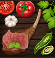 lambchop with fresh vegetables on wooden board vector image