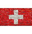 Grunge flag of Switzerland on a brick wall vector image