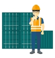 Stevedore standing on cargo containers background vector image