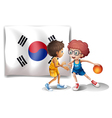 Two boys playing basketball in front of the Korean vector image vector image