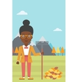 Woman with rake standing near heap of autumn vector image