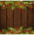 Fir branch and red berries on a wooden background vector image