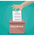 Hand putting paper in feedback box vector image