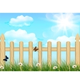 Spring background grass and wooden fence vector image