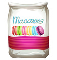 Colorful macarons in bag vector image