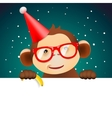 Cute monkey holding white page Christmas card vector image vector image