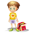 A young boy with his school bag vector image vector image