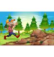 A cheerful lumberjack near the rocks vector image