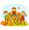 kids in a pumpkin patch vector image