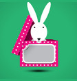 rabbit sits in box for gift with sticker vector image vector image