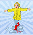 Happy girl running in puddles after rain vector image