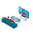 Young man seated on the couch watching tv vector image