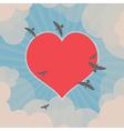 Birds flying around heart in the sky vector image