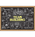 Team building on chalkboard vector image