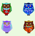 small colored owls vector image