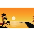 Silhouette of clump palm on seaside vector image