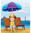 A boy with a rubber duck at the beach vector image