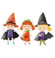 three kids in halloween costume vector image