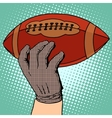 The ball of American football in his hand vector image