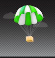 icon of package flying on green parachute vector image