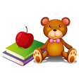 An apple above the books and a huggable bear vector image vector image