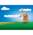 Windmill on grass field vector image