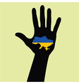 Hand with Ukraine map with the flag inside vector image vector image