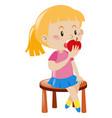 little girl eating apple vector image