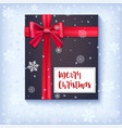 black gift box with red bow and ribbon on snow vector image
