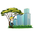A man smoking under the tree across the buildings vector image