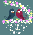 A pair of birds on a branch with flowers on a blue vector image