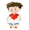 cute boy in red shirt reading book vector image