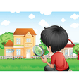 A boy with a magnifying glass studying the grasses vector image