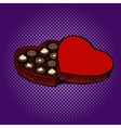 Heart shaped box with chocolate candies pop art vector image