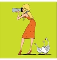 Girl photographer and geese in nature vector image