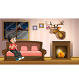 A boy sitting at the sofa near the fireplace vector image