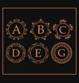 calligraphic monogram golden emblem swirls design vector image