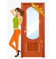 woman standing near the door vector image