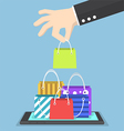 Businessman hand picking shopping bag on tablet vector image