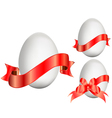 easter eggs with red ribbons vector image