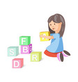 little girl builds pyramid of cubes with letters vector image