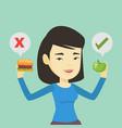 woman choosing between hamburger and cupcake vector image