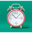 Red vintage alarm clock on green background vector image