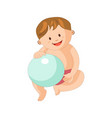 adorable little boy sits with inflatable blue ball vector image