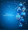 Christmas balls on blue background vector