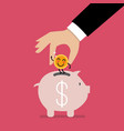 hand insert happy coin into piggy bank vector image vector image