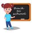 Back to school cute girl standing near blackboard vector image