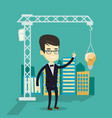man pointing at idea bulb hanging on crane vector image