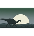 Silhouette of Iguanodon with moon vector image