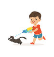 cute bully boy pouring a black cat out of a water vector image